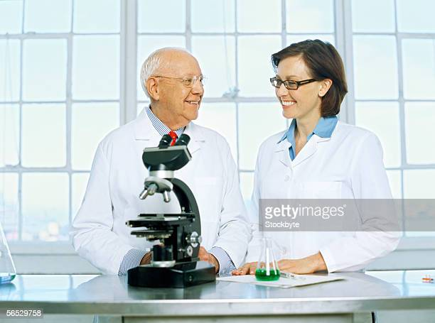 female scientist and a male scientist talking in a laboratory