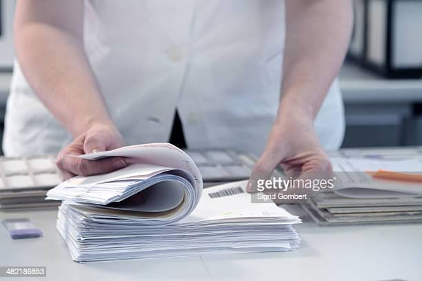Female scientist checking through paperwork