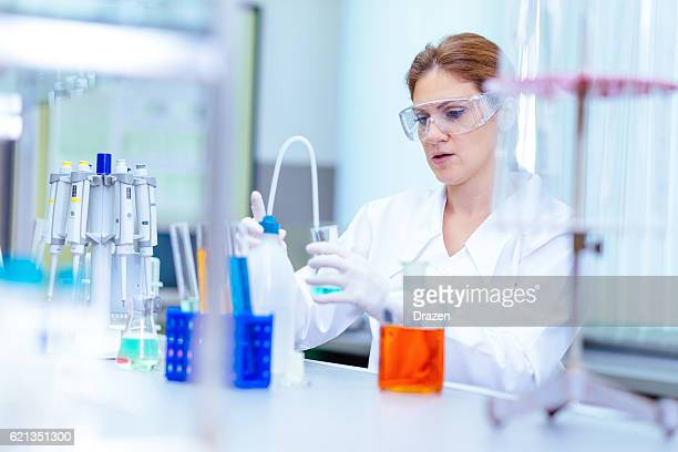 Female scientist in forensic laboratory