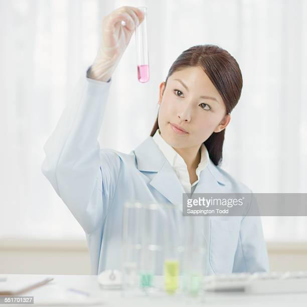Female Scientist Looking At Chemical