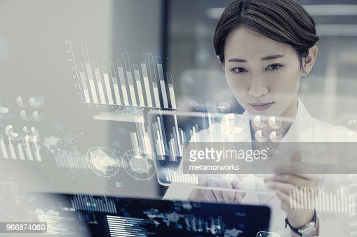 Female scientist looking futuristic GUI. : Stock Photo