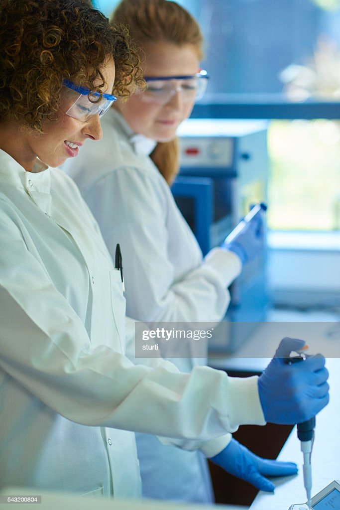 female scientist with genetic sample