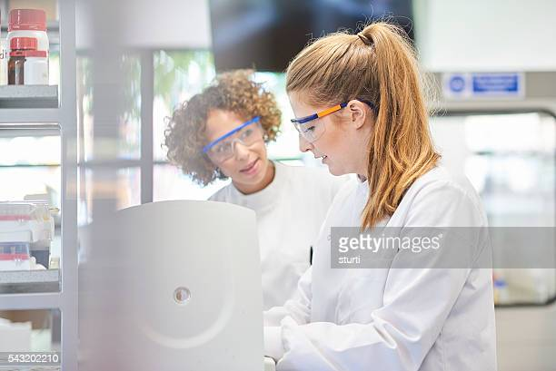 female scientists with centrifuge