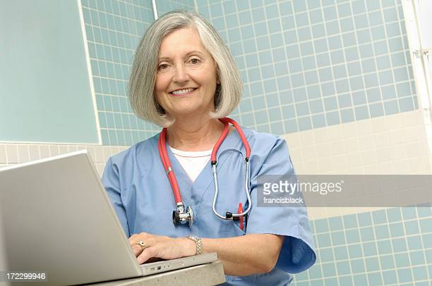 female senior doctor with laptop low angle