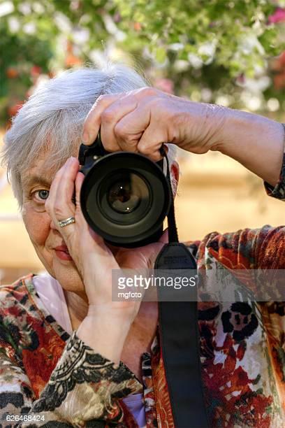 female senior with camera