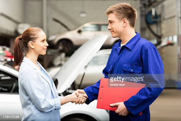 Female Shaking Hands With Car Mechanic