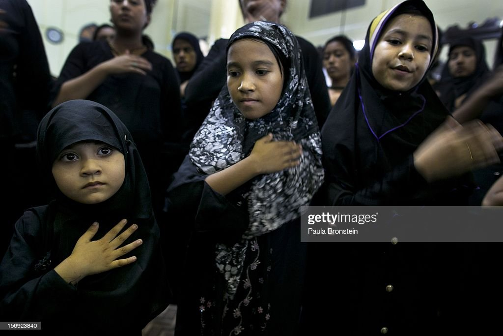 Female Shia muslims pray inside a local mosque to mark the Day of Ashura on November 24, 2012 in Yangon, Myanmar. The day of Ashura is a national holiday held on the 10th day of Muharram in the Islamic calendar, with men beating themselves as they mourn the martyrdom of Husayn ibn Ali, the grandson of the Islamic Prophet Muhammad. There are approximately 20,000 Shia muslims in Myanmar.