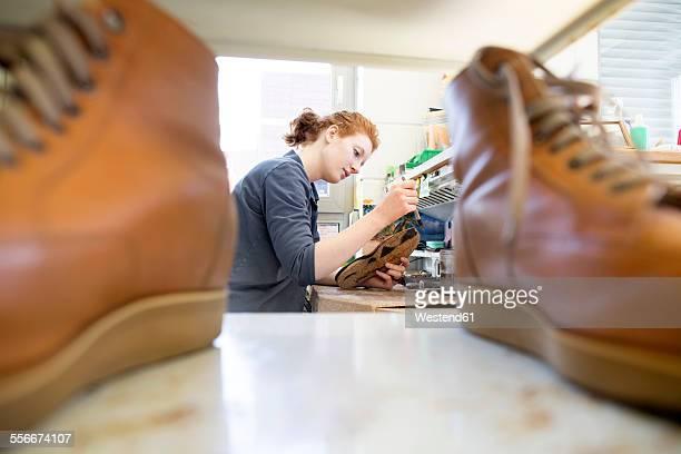 Female shoemaker in workshop