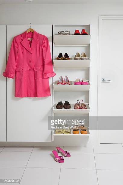 Female shoes on a shoe rack in a modern home