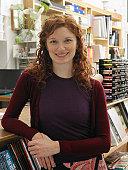Female shop assistant in art shop, smiling, portrait