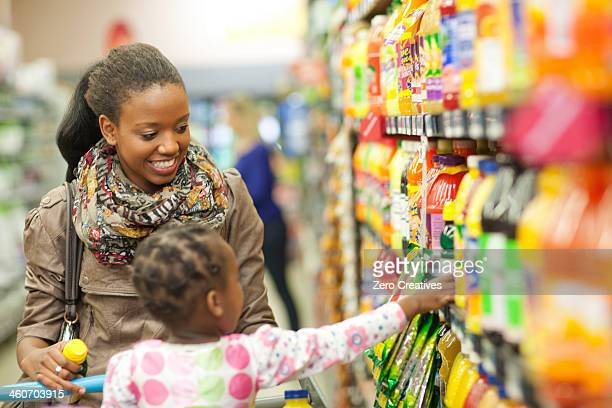 Female shopper and daughter in supermarket
