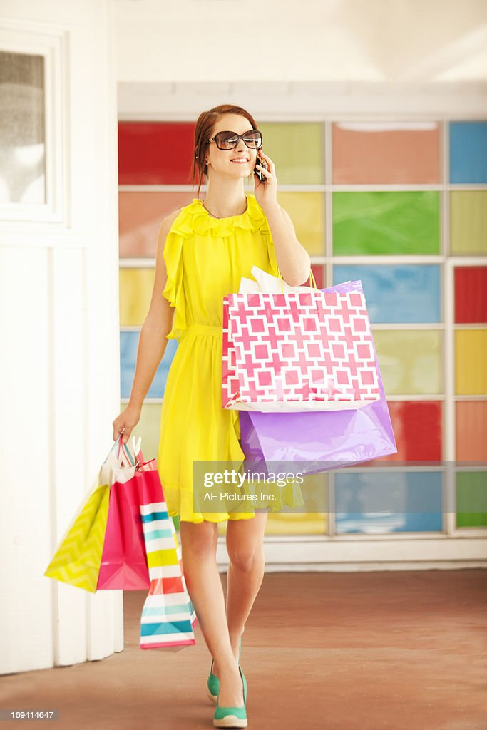 Female shopper on cell phone : Stock Photo