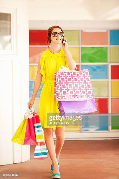 Female shopper on cell phone