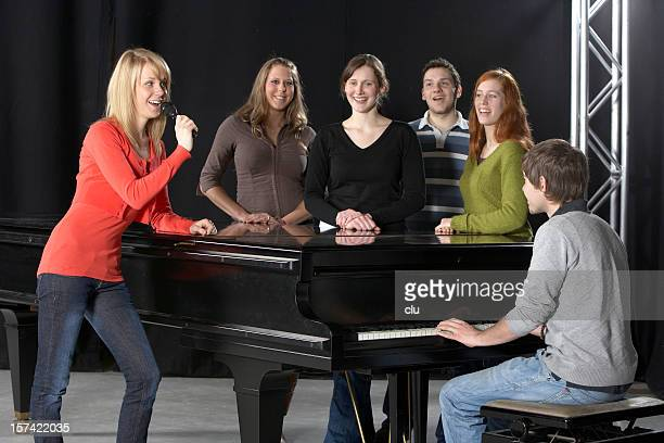Female singer, Chorus, pianist and grand piano
