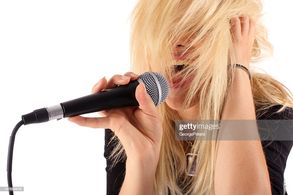 Female Singing And Microphone : Stock Photo