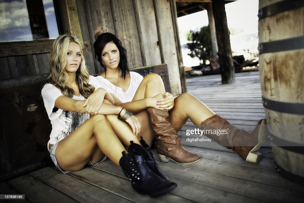 Female Sister Beauties Sitting Country Style : Stock Photo