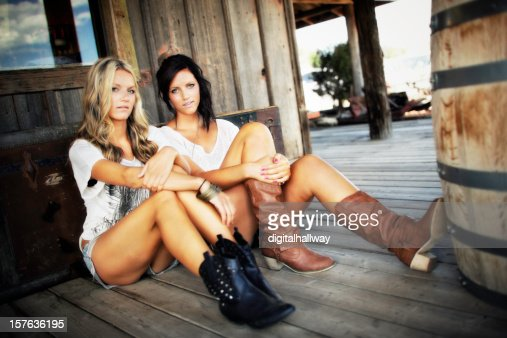 Female Sister Beauties Sitting Country Style
