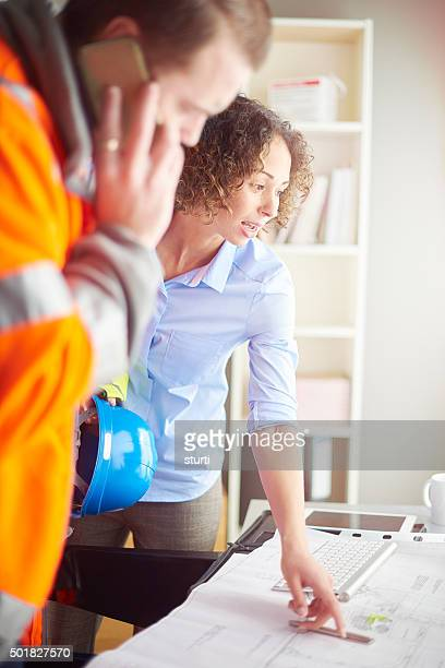 female site agent with foreman