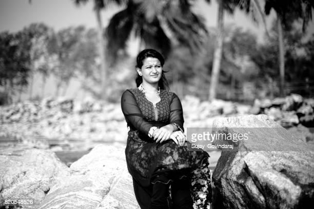 Female Sitting on the Rocks