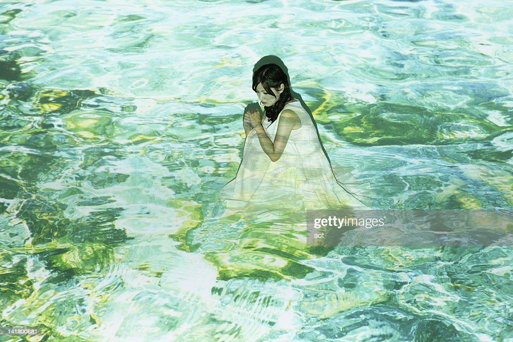 Female sitting on the sea : Stock Photo