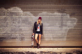 Female skater by corrugated iron
