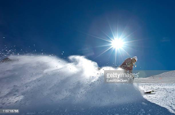 Female skier skiing in a cloud of champagne powder snow of the glacier skiing area of Val Senales on April 05 2011 in Merano Italy Val Senales is a...