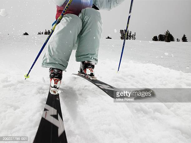 Female skier, skiing on slope (low section)