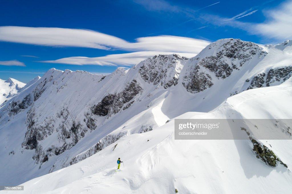 Female Skier standing on a mountain ridge, Sportgastein, Bad Gastein, Salzburg, Austria : Stock Photo