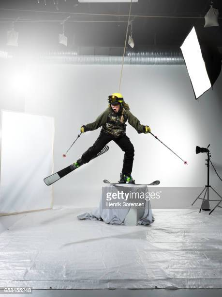 Female skiier in a studio