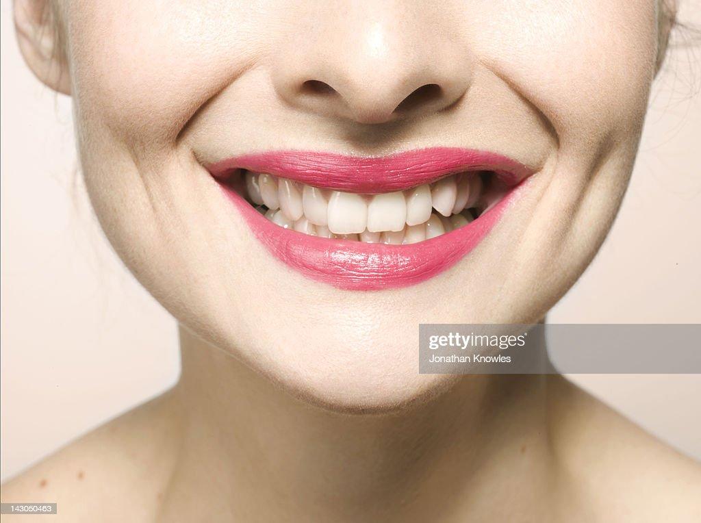 Female smiling, close up on lips : Stock Photo