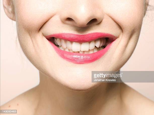 Female smiling, close up on lips