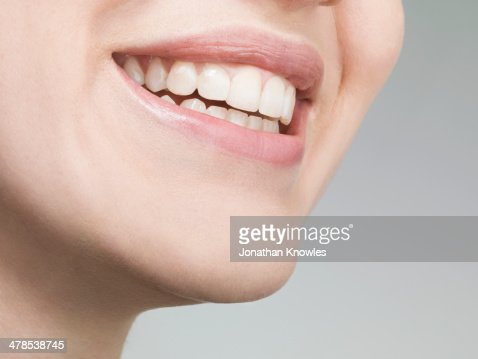 Female smiling with perfect teeth, natural