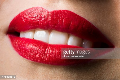 Female smiling with red lipstick on, perfect teeth : Stock Photo