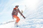 female snowboarder having fun on ski track