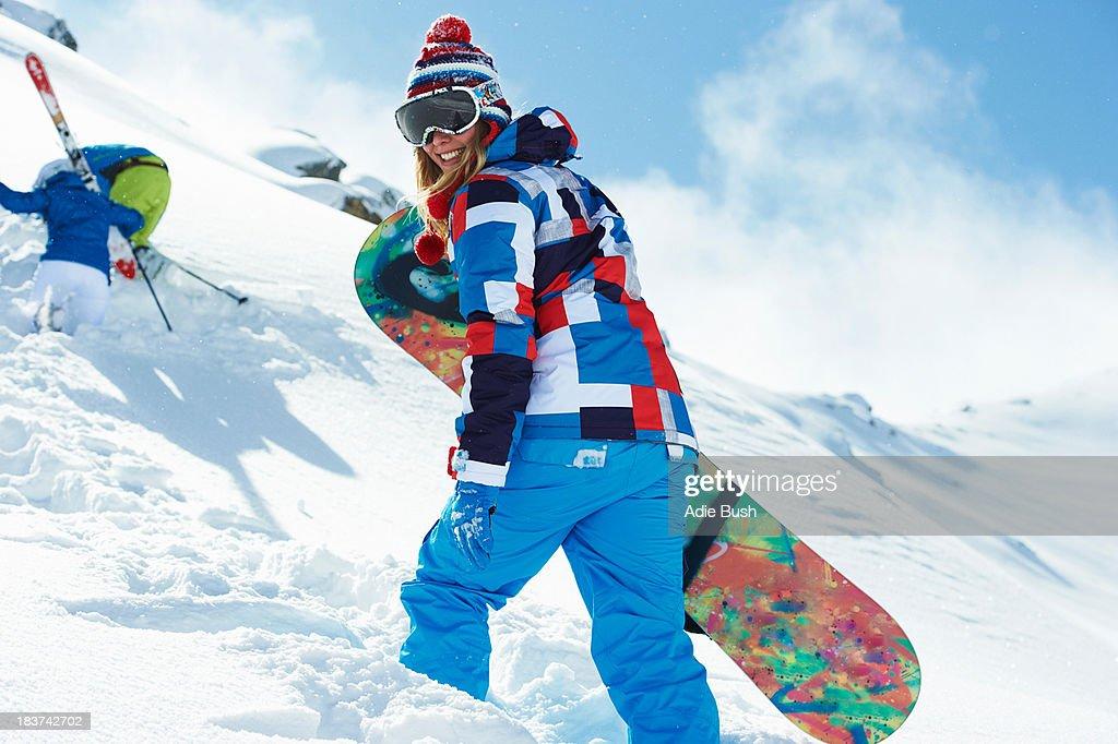 Female snowboarder in snow
