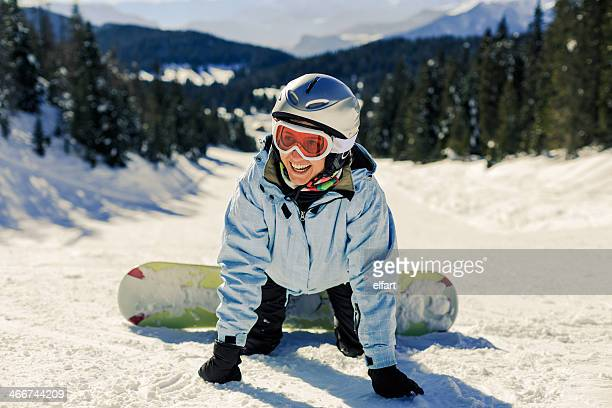 Female Snowboarder learning