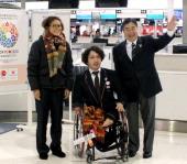 Female Soccer player Homare Sawa Paralympic swimmer Takayuki Suzuki and Tokyo 2020 Olympic Games bidding committee CEO Masato Mizuno pose for...