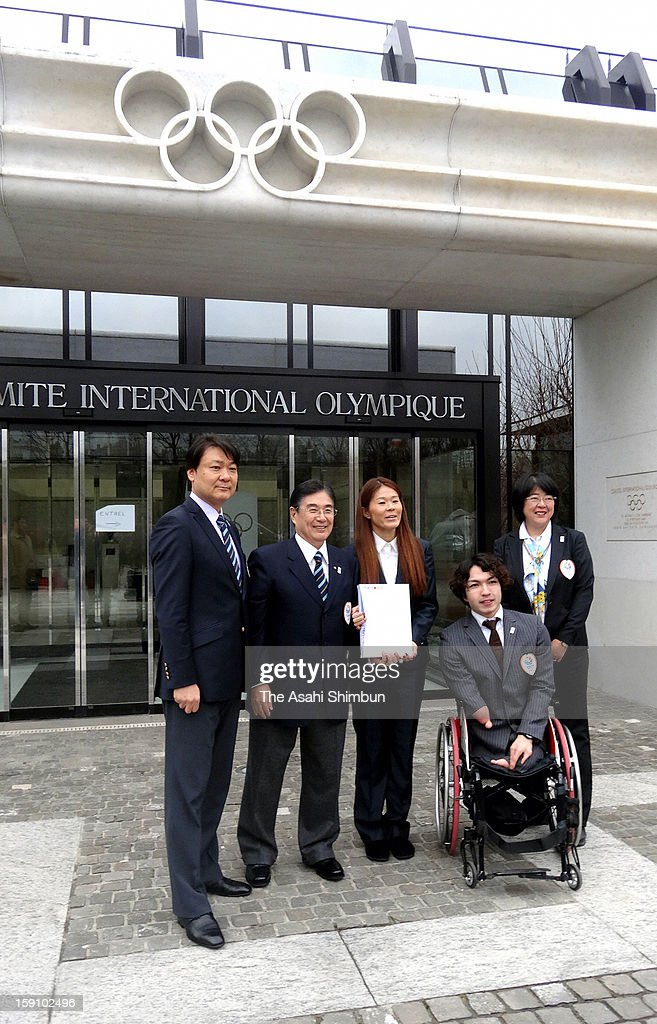Female Soccer player Homare Sawa (C), Paralympic swimmer Takayuki Suzuki (2R) and Tokyo 2020 Olympic Games bidding committee CEO Masato Mizuno (2L) pose for photographs in front of International Olympic Committee headquarters on January 7, 2013 in Lausanne, Switzerland.