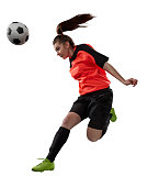 female soccer player jumping for a header isolated on white background