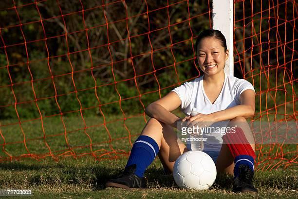 female soccer player  resting