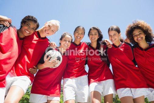 Female soccer team against clear blue sky