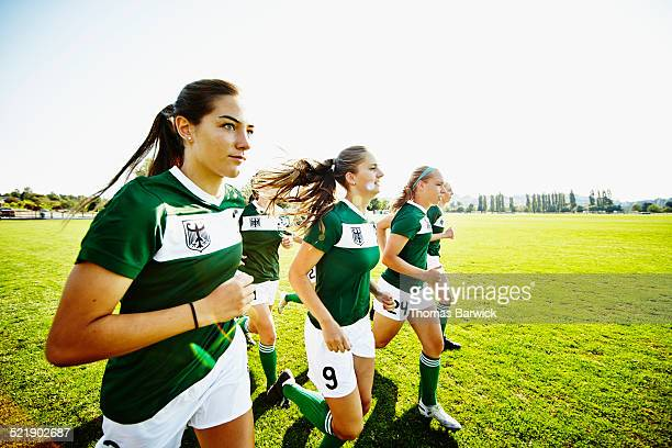 Female soccer teammates warming up before match