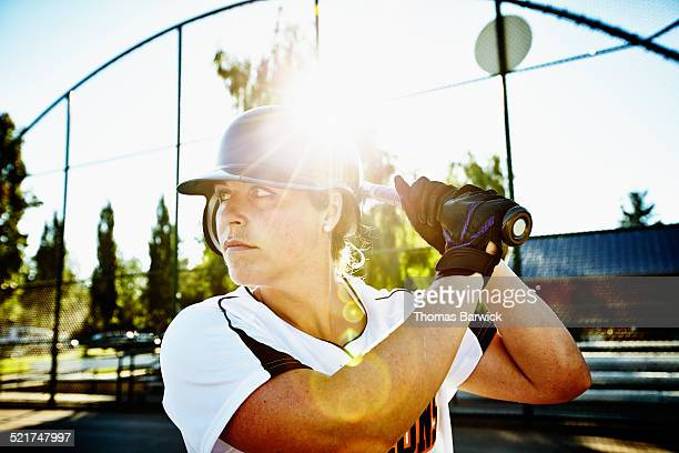 Female softball player at bat at home plate