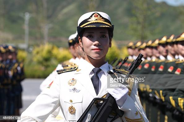 A female soldier from the Chinese People's Liberation Army attends a training session for the September 3 military parade to mark the 70th...