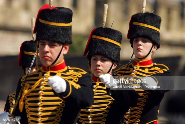 A female soldier from the Kings Troop Royal Horse Artillery parades past St Georges Chapel at Windsor Castle