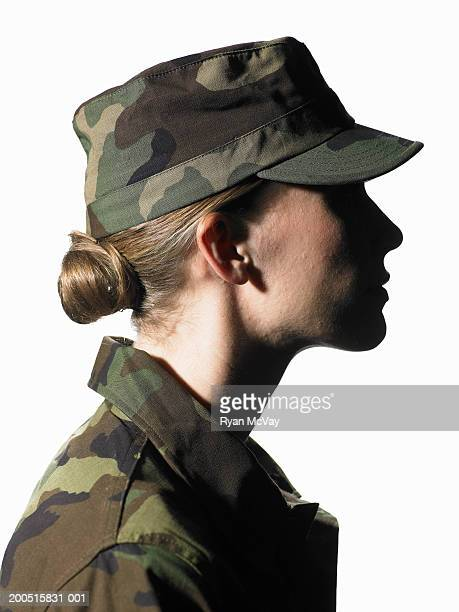 Female soldier wearing army uniform, side view