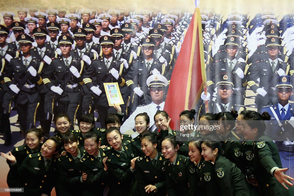 Female soldiers pose for photos as visiting an exhibition entitled 'Scientific Development and Splendid Achievements' before the18th National Congress of the Communist Party of China (CPC) on October 31, 2012 in Beijing, China. The exhibition showcases China's progress in political, economic, cultural and ecological spheres over the past decade. The18th National Congress of the Communist Party of China (CPC) is proposed to convene on November 8 in Beijing.
