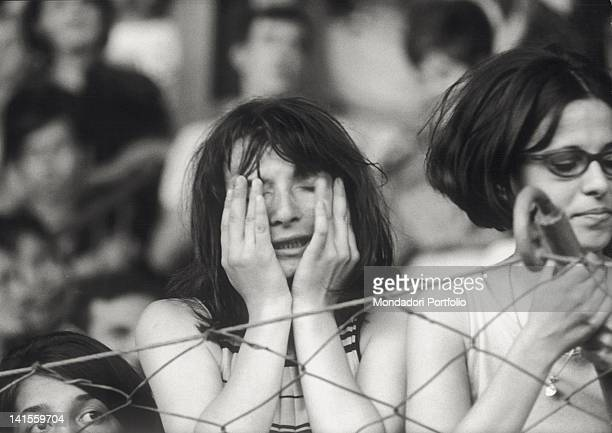 A female spectator crying at the Beatles concert held at the Velodromo Vigorelli Milan 24th June 1965