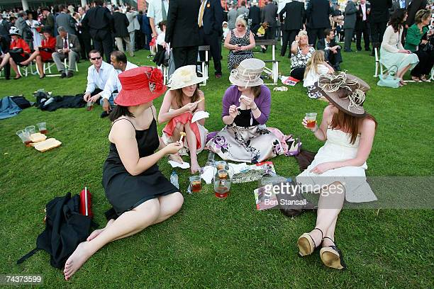 Female spectators enjoy scampie and chips with Pimms on the viewing lawn infront of the Queen Stand on Ladies Day at the Epsom Derby on June 1 2007...