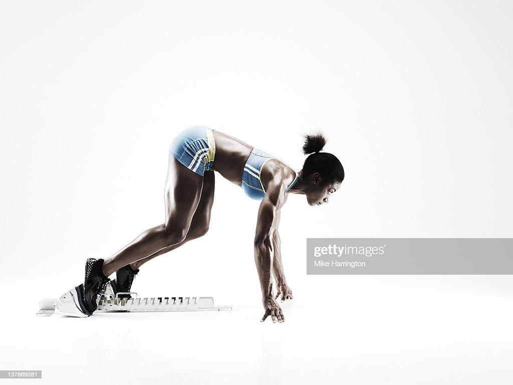 Female Sprinter On Starting Blocks